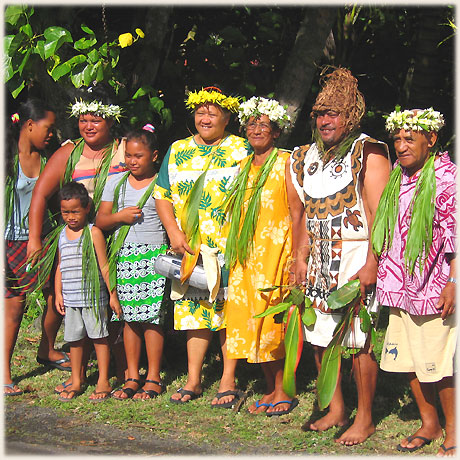Smiles of pride from a traditionaly dressed Rarotonga family as they wait their turn to join the Queen's Baton Relay on Thursday on 12th Jan. 2006.