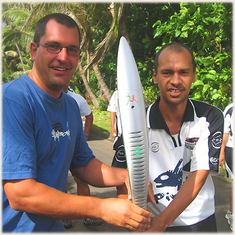 A carrier in the Queen's Baton Relay in Rarotonga on 12 th January 2006 was happy to allow onlookers the chance to briefly touch the baton, including Sokala guest Thomas.