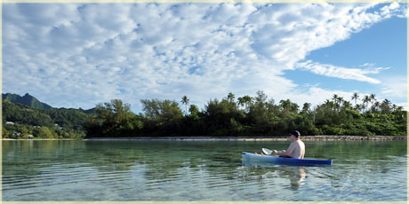 Karsten our guests paddling on the calm lagoon