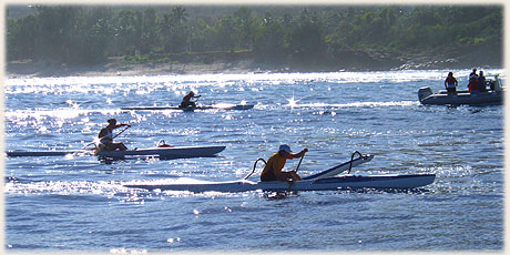 women paddlers at 07:30 am during start of Round Raro OC1 Relay Race / Photo by Archi © sokalavillas.com